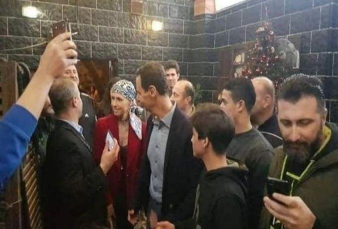 إمرأة تفاجئ بشار الأسد ، فضحك البعض