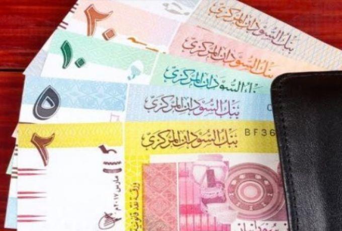 السودان..مجهولون يقومون بتوزيع وحرق عملات نقدية بمعسكر في أمبدة